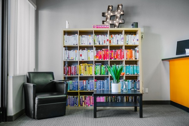 A bookshelf containing different colored books.